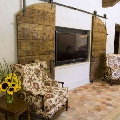 Barn Door Entertainment Center & many other ways to hide a TV in plain site in the middle of your living room