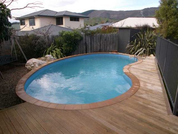 Small kidney shaped inground swimming pool designs with decks