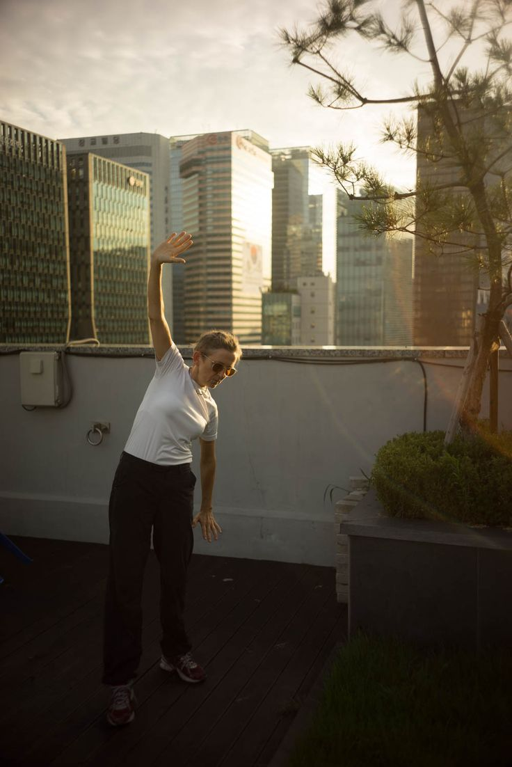 Kjersti performing Qi Gong on the rooftop terrace of our hotel