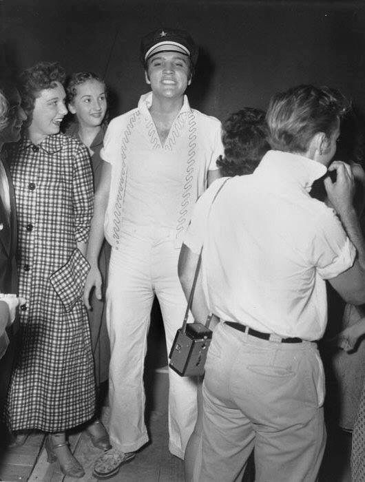 Elvis at the Mid-South Fair in Memphis, Sept.29, 1956... and the back of actor Nick Adams