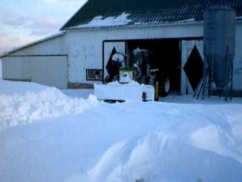 John Deere 8430 Plowing through 6 foot snow drift