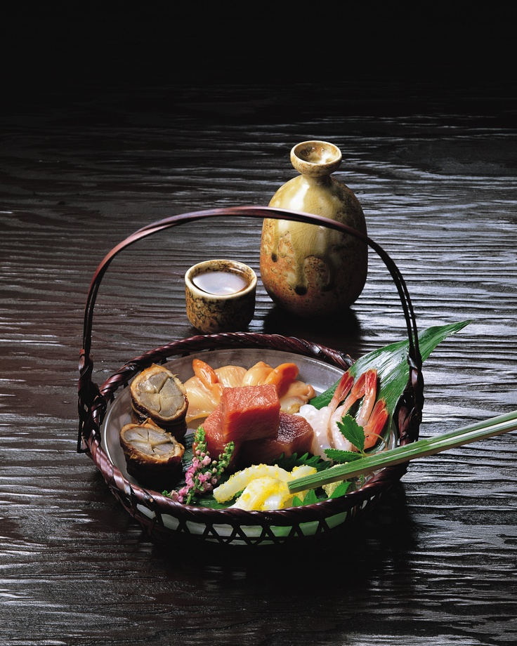 Elegant Serving of Sashimi with Japanese Sake 刺身