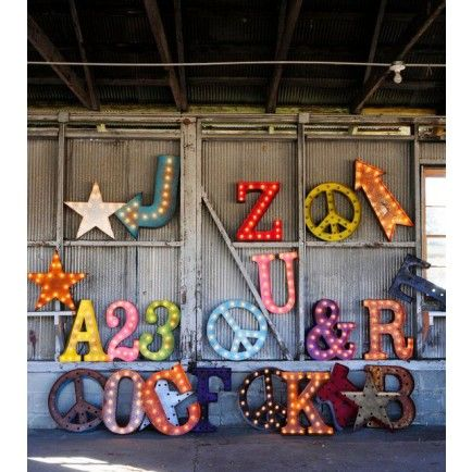 The letters to make the words that will make the quotes... Fun marquee lights on display in an old barn. #hardtofind #colour #festival #typography