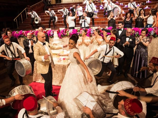 Wedding entertainment: Couple brought in traditional Lebanese drummers and two Lebanese bands to entertain guests at their wedding, held at Sydney Town Hall