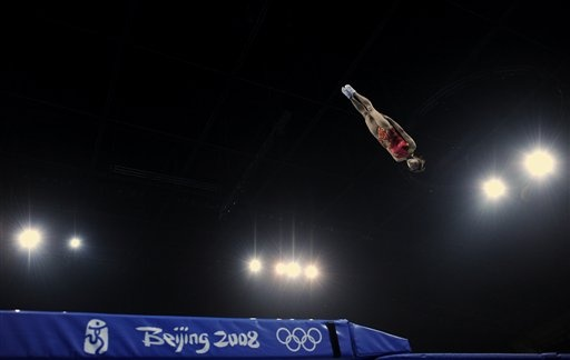 China's gymnast gold medal winner He Wenna performs on the trampoline during a gala show - Beijing Olympics 2008