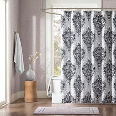 Sydney is the perfect way to make a fashion statement in your bathroom. The large black and gray damask print creates a dramatic look with this comforter. The reverse is a solid black.