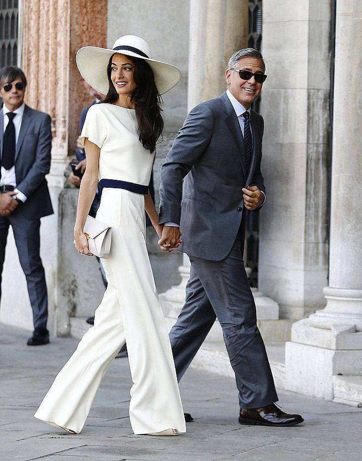 Amal Alamuddin Style Pictures | POPSUGAR Fashion ==== modesty has its rewards. To be sure, Amal's mother is the smart one - much smarter than average.