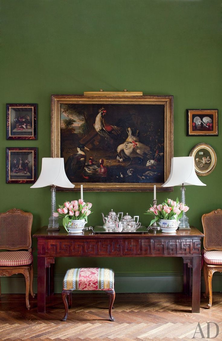 "In Fernanda Kellogg and Kirk Henckels's Manhattan apartment, wool baize lines the dining room walls; the oil painting of barnyard fowl is in the manner of Flemish Old Master Roelandt Savery. Design by Brockschmidt & Coleman. Photograph by Roger Davies. From ""Living Legacy,"" Architectural Digest (December 2011)."