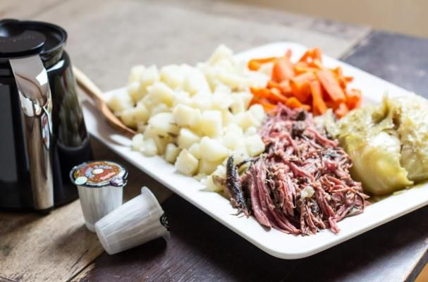 Coffee Braised Corned Beef | This slow cooker coffee braised corned beef is a twist on the classic.  The coffee adds robust flavor to the beef while it simmers low and slow for 8 hours.  The result is fork tender corned beef that melts in your mouth.