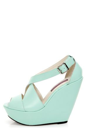 Check it out from Lulus.com! The Mojo Moxy Creamy Mint Peep Toe Platform Wedges are the stuff that dreams are made of! Smooth mint green leather forms a pretty peep toe vamp, with crisscrossing straps above that fasten to the heel cup with a silver buckle (and hidden elastic). Wrapped platform builds from 1.5