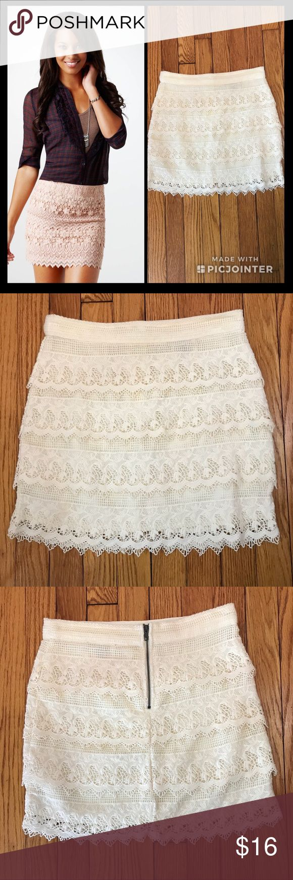 """American Eagle Lace Tiered Mini Skirt (Size 2) Gorgeous American Eagle lace tiered crochet skirt. Soft cotton lace, Crocheted lace tiers, Grosgrain ribbon waistband, Full satin lining, Back zip,  length is 15"""" from center back. , size 2 in off-white. Made from shell/cotton/lining/polyester. Cannot see through it because of the lining. American Eagle Outfitters Skirts Mini"""