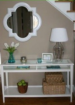 living room wall color - like the decorations in the table ! cute colors ! Love the wall color.