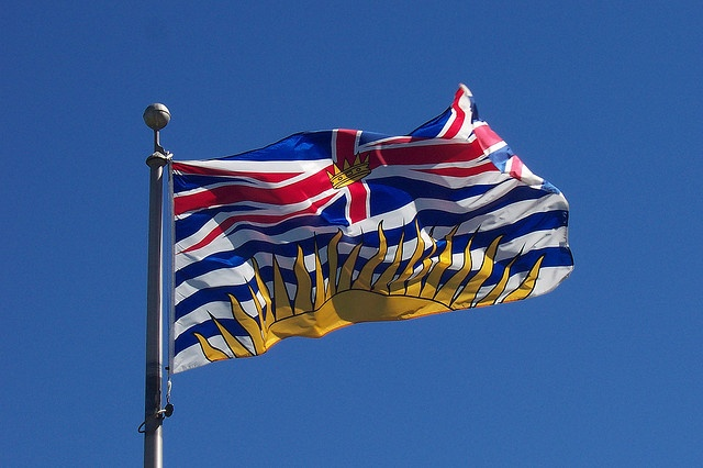 The flag of British Columbia outside the Parliament Building in Victoria, British Columbia, Canada, 2007, photograph by Neil Willsey.