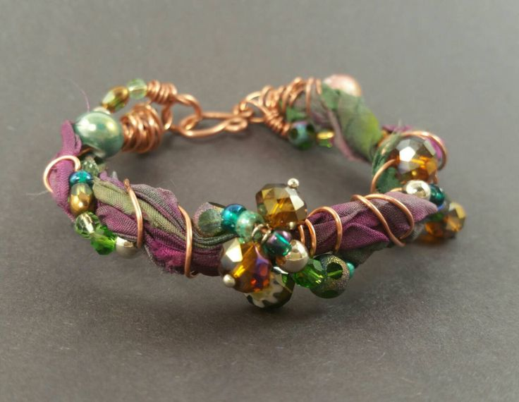 Bohemian recycled sari silk ribbon bracelet with beaded copper wire, glass beaded bracelet with copper and upcycled sari ribbon, mixed media by BeadOnAWireLuv on Etsy https://www.etsy.com/listing/257070423/bohemian-recycled-sari-silk-ribbon