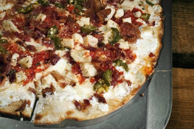 """""""The Dream"""" pizza at Olivella's Lakewood is topped with house-made mozzarella, Gorgonzola, tomato sauce, chicken, pancetta and jalapenos."""