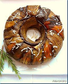 Ένα φαγητό ΟΝΕΙΡΟ!!!! Υλικά 2-3 μεγάλες μελιτζάνες φλάσκες,σε φέτες τηγανισμένες 1 μελιτζάνα ψημένη στα κάρβουνα ή στο μάτι της κουζίνας...