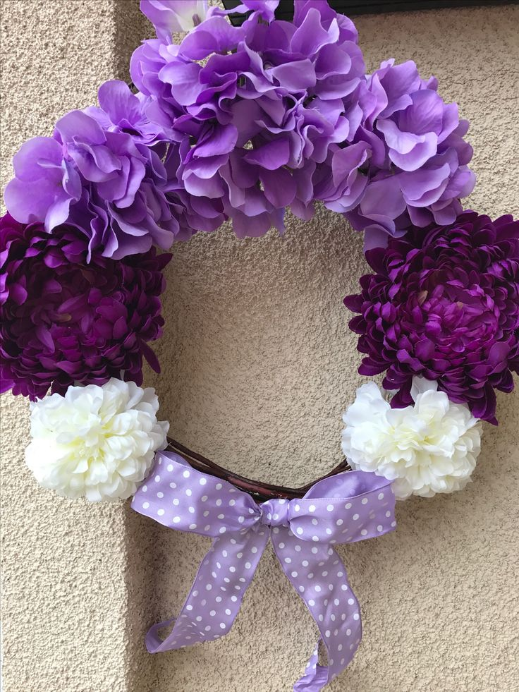 Memory wreath for my Grandmother's birthday, placed on her headstone at the cemetery. Multiple shades of purple and white flowers and lavender ribbon hot glued to a grapevine wreath - all from Michaels. Total cost $16.