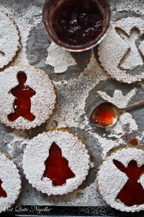 Christmas Linzer Cookies: Christmas-themed cookie cutters are the secret to creating festive treats like these. These linzer cookies are cut in traditional Christmas shapes for a holiday themed spread. Find more easy and delicious linzer cookie recipes and ideas for Christmas here.