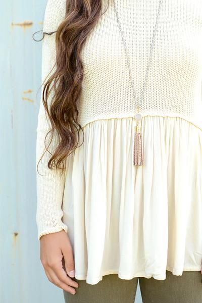 Oh yes! This cream colored peplum style sweater by Black Swan has stolen our hearts! We are obsessing over how comfortable and girly this piece is. It's warm and comfortable on the top, and flowy and