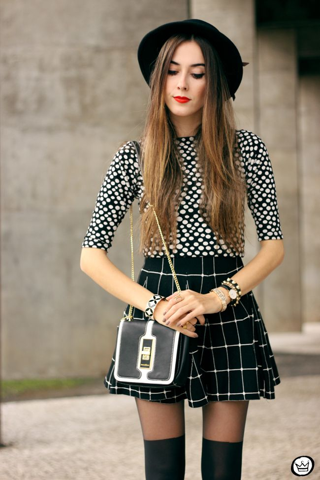 Perfect mix of prints in black & white, wearing dotted top and plaid skirt.