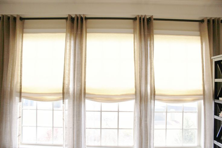Contemporary Home Interior Design With Stunning Cordless Roman Shades: Vivacious Cordless Roman Shades With Beige Paint Walls And White Frame Window For Modern Home Interior Design