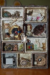 Decorated Tim Holtz configuration box.
