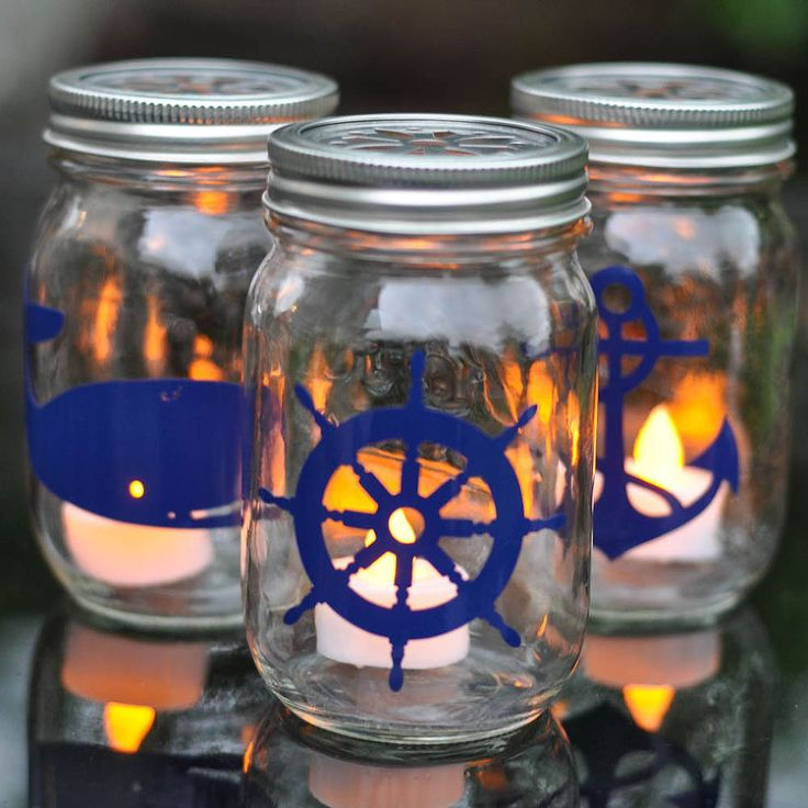 Nautical Mason Jar Lanterns - These mason jar lanterns are easy to make, and have great impact on the patio. Use vinyl, decals, or scrapbooking embellishments t…