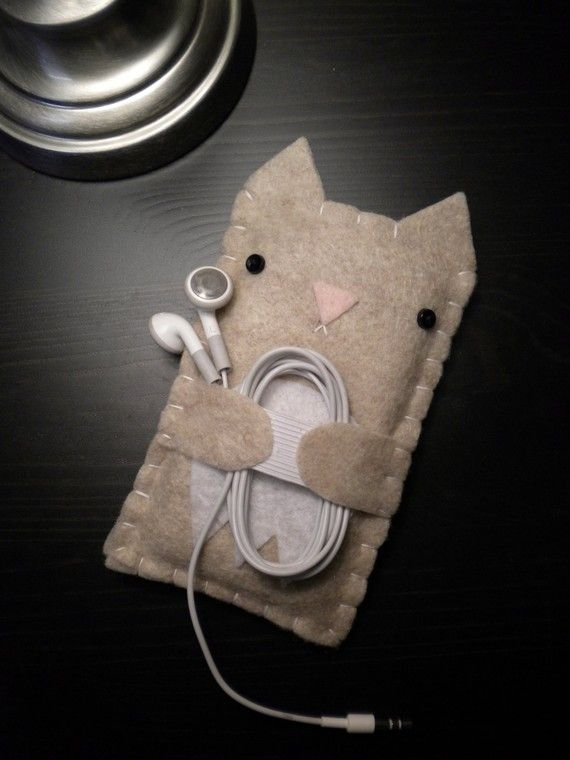 Kitty hug phone and earbud holder. This is from an Etsy listing but looks very easy to make.