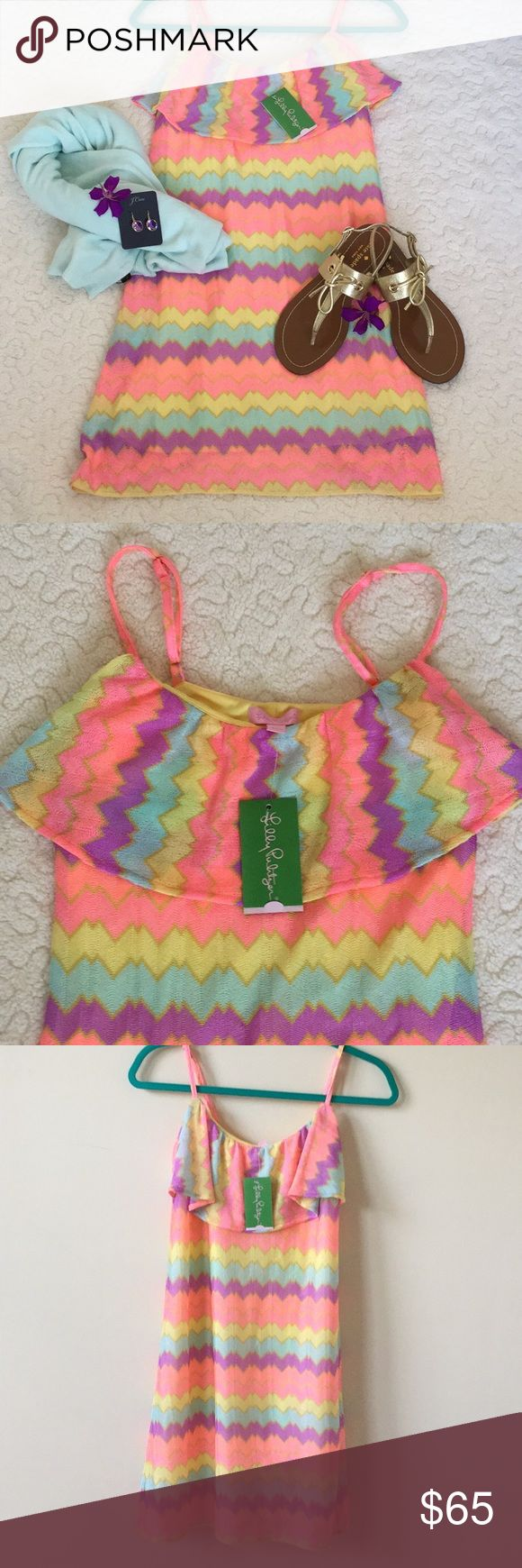 "🌸SALE$56🌸Lilly Pulitzer Laya Dress NWT Fun and flirty Lilly Pulitzer dress in multicolored chevron stripe.  Pink, yellow, peach, aqua and lavender... such vibrant, happy colors! Adjustable spaghetti straps, flounce on front yoke. Fully lined. 100% polyester. Length from underarm to hem 28"". Never worn, new with tags! So cute!! Was $65 now $56 Lilly Pulitzer Dresses"