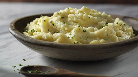 KNORR Savoury Mashed Potatoes 1 1/2 lbs. potatoes, peeled and cut into 5 cm- chunks 1 clove garlic 1/2 cup milk 1 pot Knorr® Homestyle Stock Chicken 1 Tbsp. margarine 1 Tbsp. chopped fresh herbs  1.Cover potatoes and garlic with water in a large saucepot. Bring to a boil over high heat. 2.Reduce heat to low and simmer 10 minutes or until potatoes are tender; drain. 3.Return potatoes to saucepot; mash. Stir in Knorr® Homestyle Stock Chicken, Mrgarine & remaining ingredients until melted.