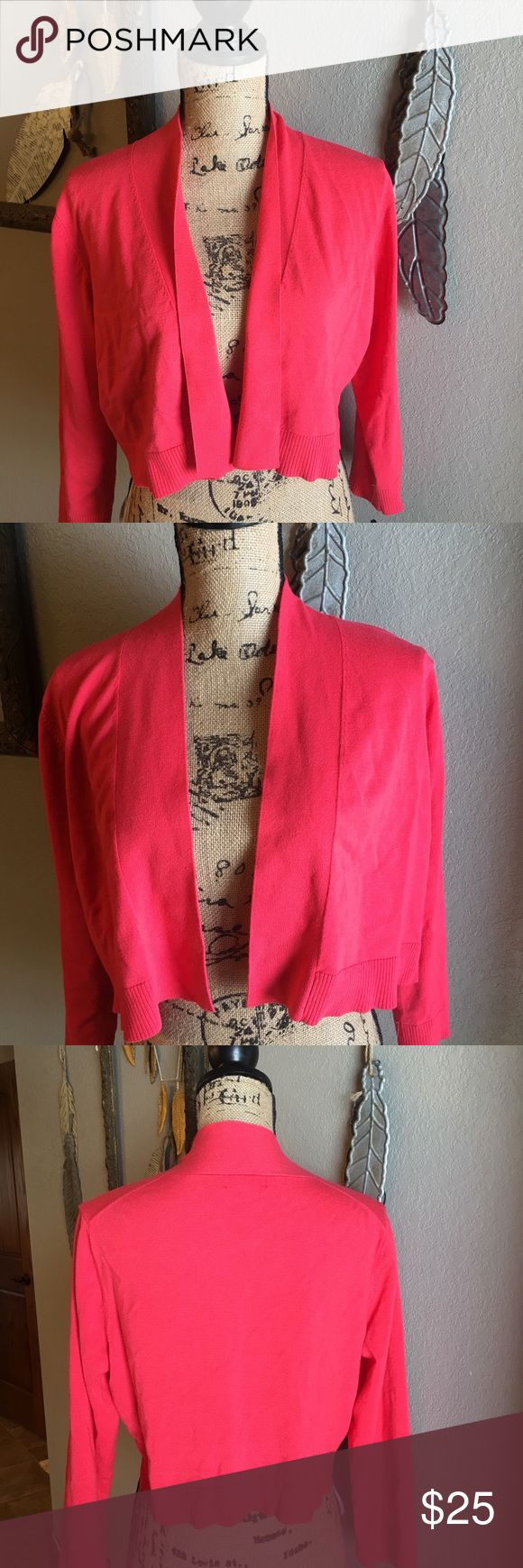 Calvin Klein Coral Shrug Sweater XL NWT Calvin Klein Coral Shrug Sweater XL NWT. This sweater is super versatile an can be worn over a sundress or with pants. This color looks beautiful with olive green and many other colors. Calvin Klein Sweaters Shrugs & Ponchos