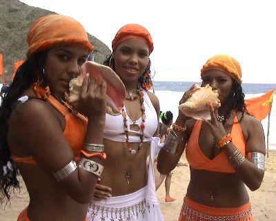 Afro Venezuelan dancers/chorus girls of Tambor Urbano demonstrate the use of the guarura.