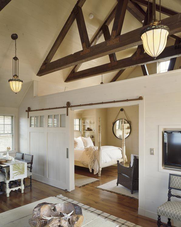 open-floor plan: master bedroom - love the mirror, four post bed, floors, open beams, ceiling pendants, neutral tones