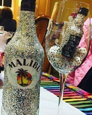 Made this for my daughter's good friend. Glittered up Malibu bottle and mini liquor bottles. #gift #glittermakeseverythingbetter #dyi #malibu #lovetocraft