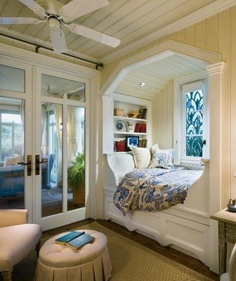 Peaceful bedroom. Love the stained glass window and built in nook.