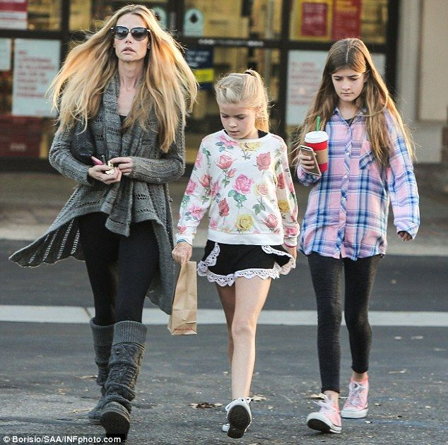 On the move: Denise Richards was spotted running errands in Malibu with her daughters, Lo...