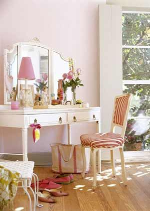 Layers Of Pink In Different Shades Include The Pale Wall Color, A Preppy  Lampshade, And Striped Chair Fabric.