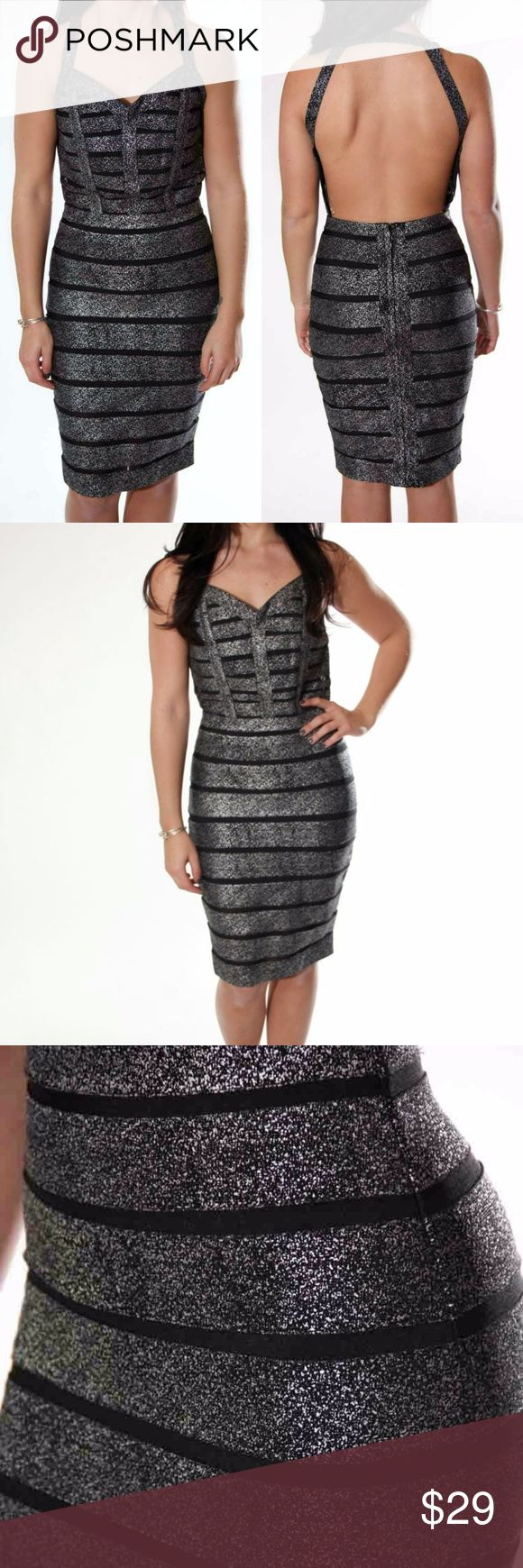 """Speckled Bandage Midi Dress Speckled silver bodycon dress with mesh lines running horizontally throughout the bodice, halter neck, and sultry open back. Hidden back zipper.   Unlined Bodycon 90% Polyester. 10% Spandex. Hand wash Measured from a small. 35 ½"""" Full length. 29"""" Bust. 25"""" Waist. Model is wearing a small. Her measurements are: Height 5'2"""" 