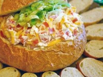 Chopped rotisserie chicken, crumbled bacon, Co-Jack cheese and tomato are stirred into a mixture of cream cheese and mayo, and served in a bread bowl.