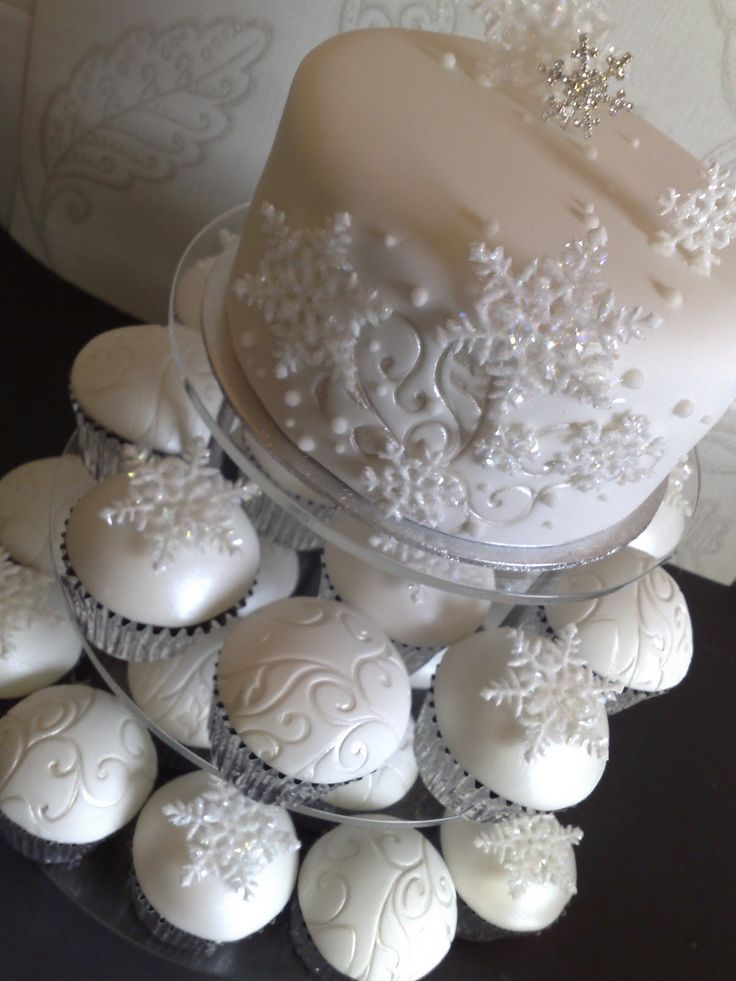 Swirl patterns are lovely. Ivory can work just as well as white for a winter themed wedding cake