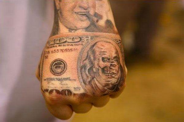 Money hand tattoo