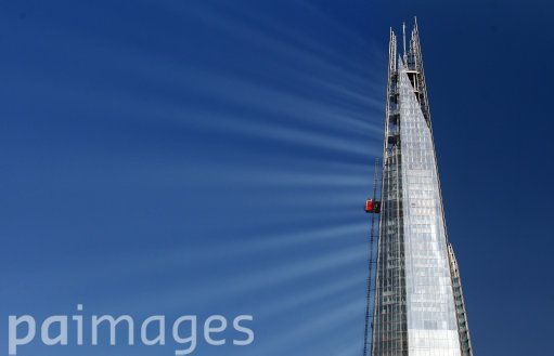 Sunlight reflects off The Shard in central London as construction continues on the building.