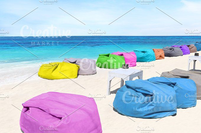 colorful chair on the beach by Trefilova Anna on @creativemarket