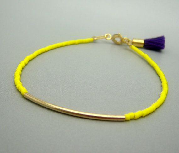 Neon Yellow Beaded Bracelet w/ Tiny Gold Bar & Purple Tassel- Friendship Bracelet. $18.00, via Etsy.