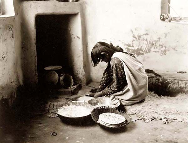 Above we show a remarkable photo of a Zuni Bread Maker. It was made in 1903 by Edward S. Curtis.    The illustration documents the Zuni woman making bread in a traditional Indian fashion.