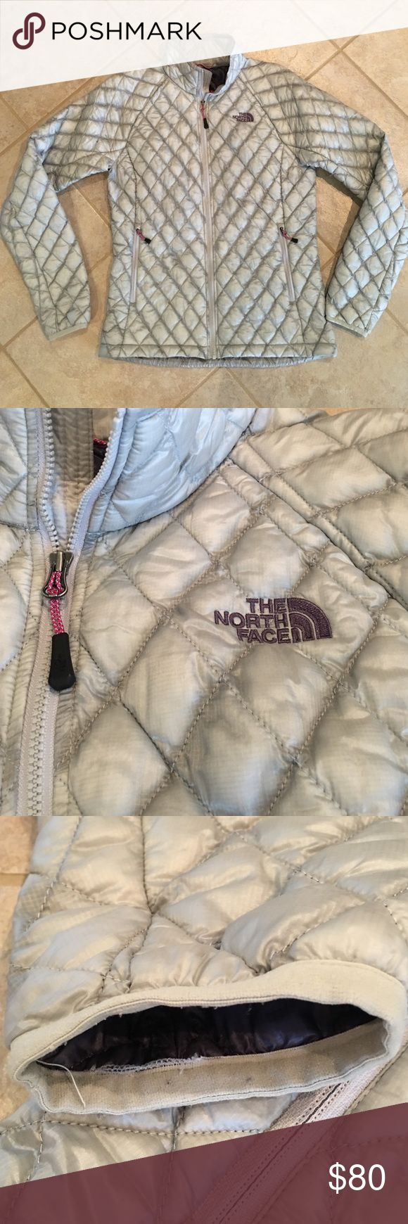 The North Face Thermoball Jacket Size S This jacket has been lightly worn but is in great used condition. Only sign of wear is at the cuffs of the sleeves, as seen in third photo. Extremely lightweight, not too puffy, and very warm. Medium grey/silver color with dark purple lining and pink accents at zipper pulls.  Smoke free home. No trades, holds, outside sales, or lowball offers. The North Face Jackets & Coats