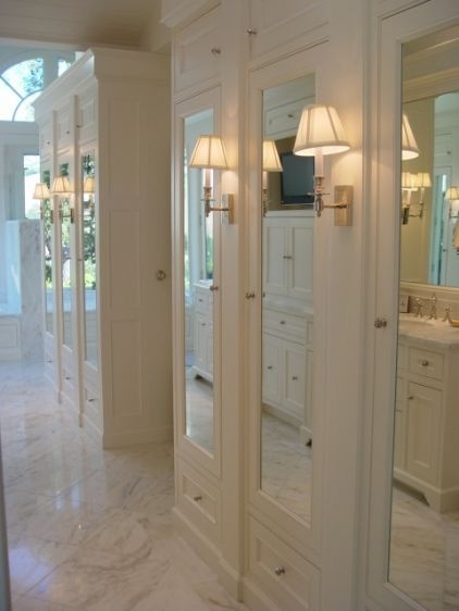 Mirror-fronted cabinets look similar to glass, but with the added benefit of keeping unsightly contents concealed.