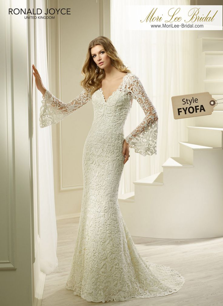 Style FYOFA HEAVEN A UNIQUE ALL OVER LACE DRESS WITH A V-NECKLINE, ILLUSION BACK AND BELL SLEEVES.PICTURED IN IVORY.AVAILABLE IN 3 LENGTHS: 55', 58' AND 61' COLOURSIVORY