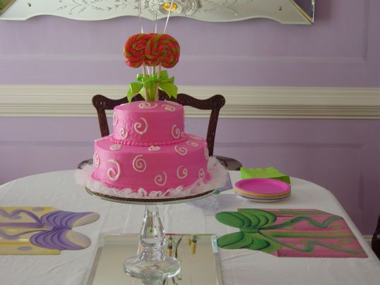 Birthday cake and lollipop themed party...esp love the party favors--lollipop drum and drumstick