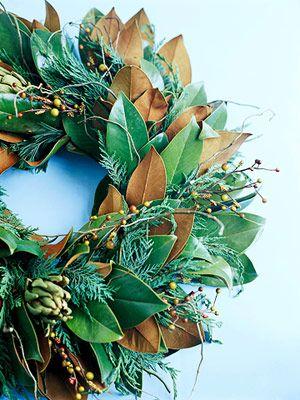 Fresh artichoke, lemon leaves, juniper branches wreath
